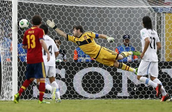 Spain goalkeeper Iker Casillas fails to save on a free-kick goal by Uruguay player Luis Suárez