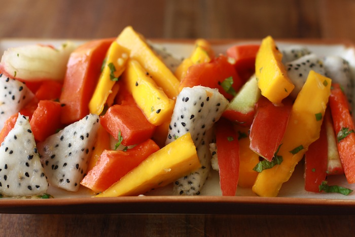 Tropical Fruit Salad with Ginger Mint Dressing by Season with Spice