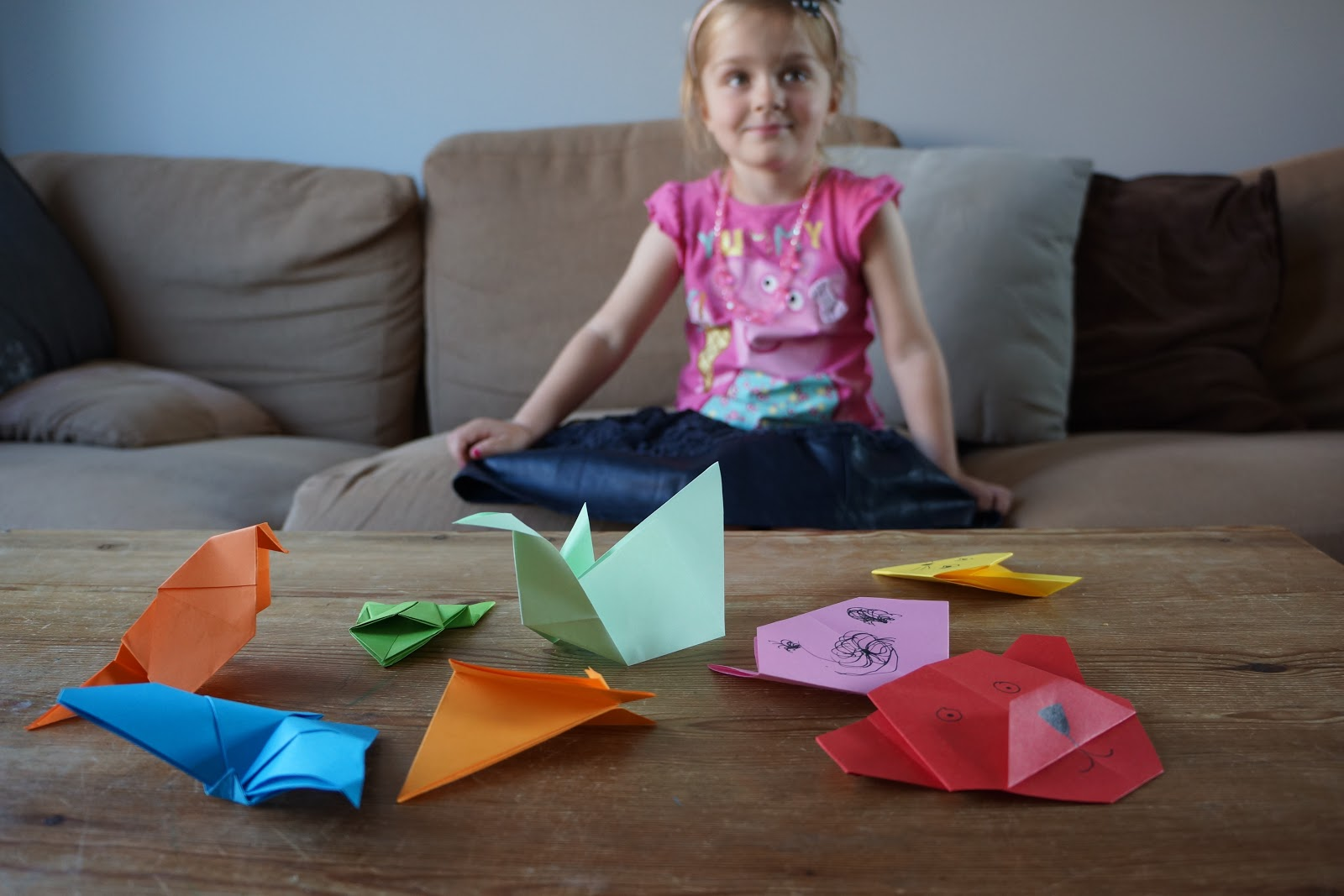 little girl with a paper zoo