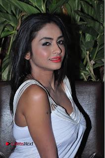 Actress Model Pooja Sri Stills in White Short Dress at F Club pre soft Launch  0220.JPG