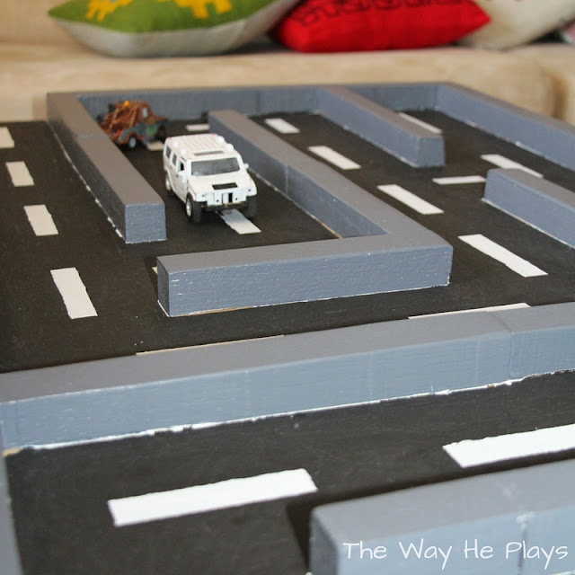 White car on wooden car maze