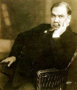 Foto de Rubén Darío sentado en un sillón