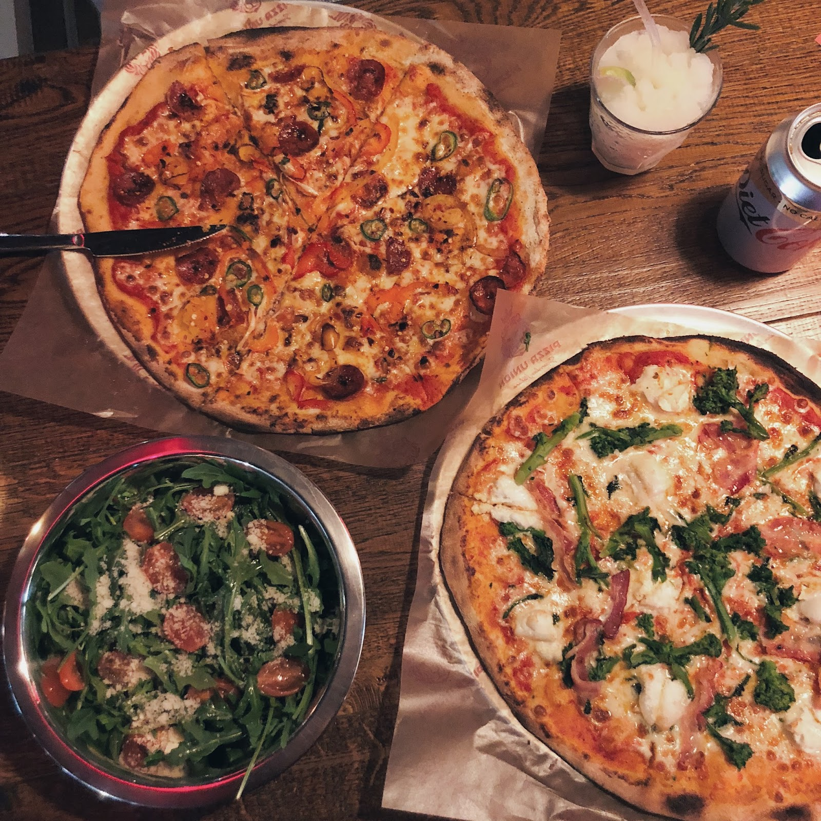 Selection of pizzas and salad