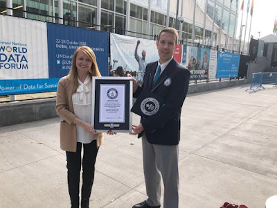 Madie Laing, RAH USA PR and Marketing Specialist receives the certification from GWR Judge Philip Robertson