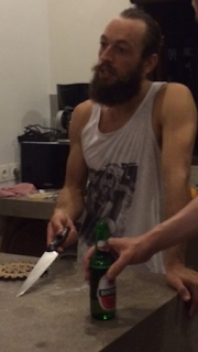 You can tell by how he holds that kitchen knife.