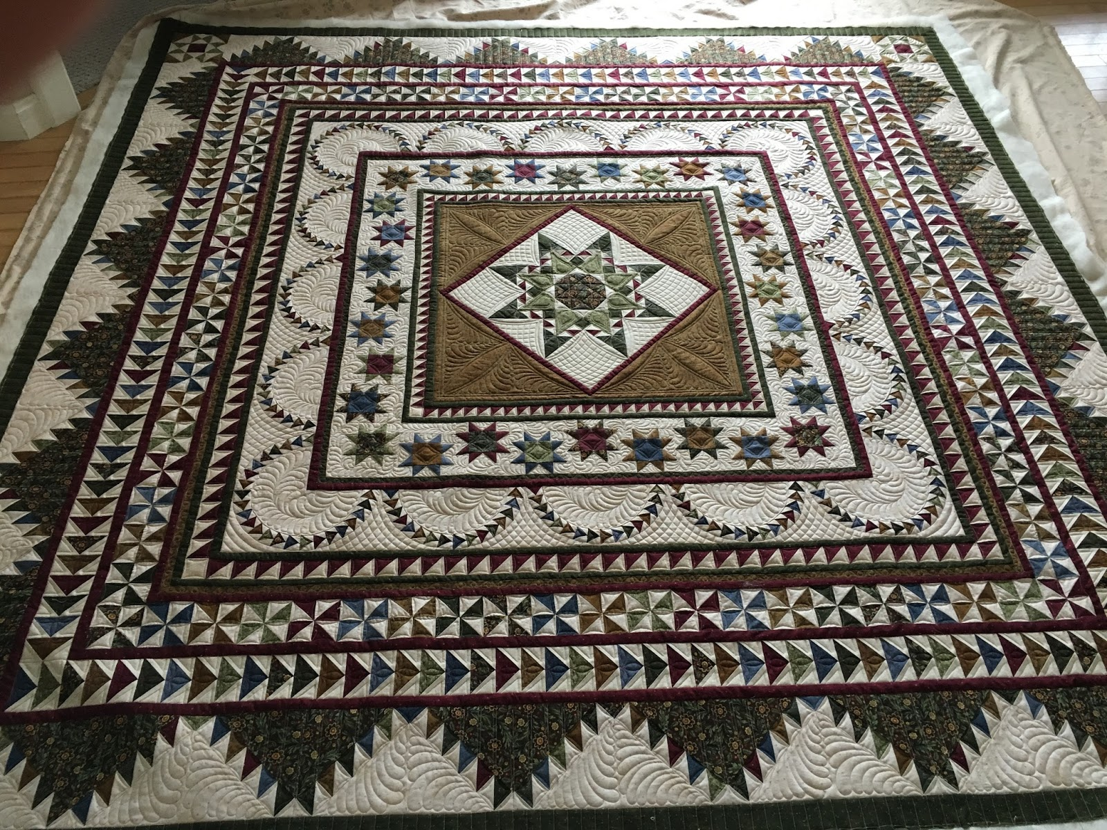 magnifico not the i are job showed but here much ivory medallion all quilt sewing on client it threads this pulled uses img too for tan fabrics gallery of just thread most a tad