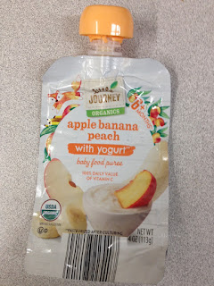 An empty pouch of Little Journey Organics Apple Banan Peach with Yogurt Baby Food Pouch, from Aldi