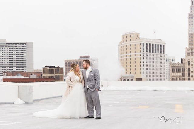 bride and groom on z belt lot rooftop in detroit smiling