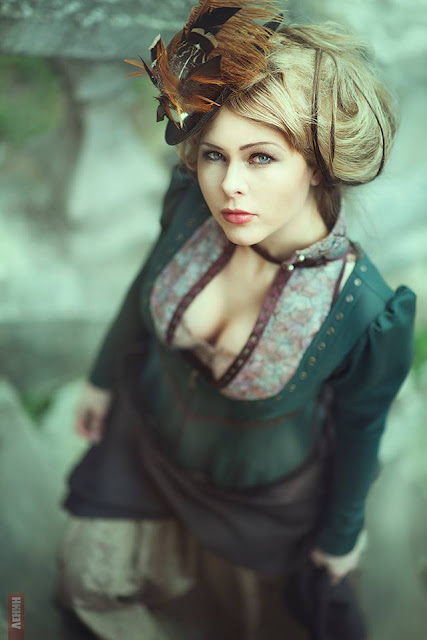 This woman is wearing a steampunk neo-victorian costume. Neo-victorian clothing is very popular in Steampunk fashion.