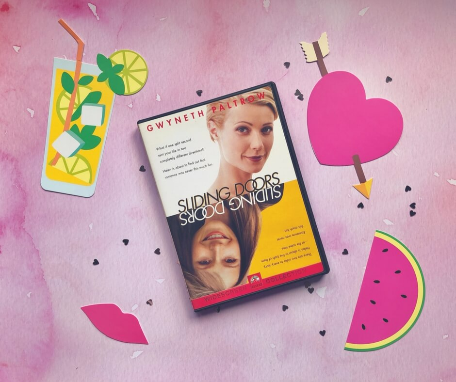 Sliding Doors DVD sits on a pink background with small silver hearts near it. In the top left is a picture of a glass of lemonade, in the bottom left is a pair of pink lips. In the top right is a pink heart with an arrow through it and in the bottom right is half a watermelon slice.
