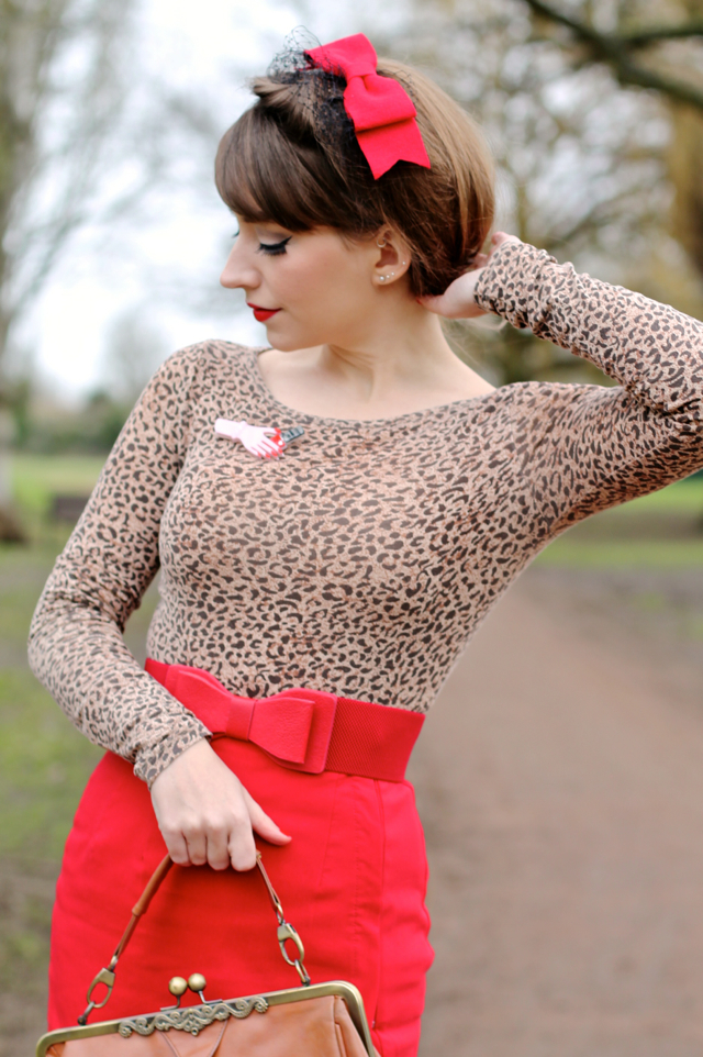 Red wiggle pencil skirt, leopard print top and Lacquer de Rouge Ertswilder brooch