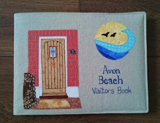 Personalised Visitors Book showing logo and Doorway of Avon Beach B&B
