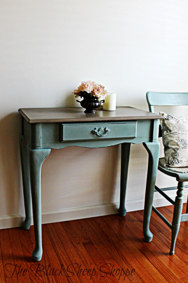 This make-up vanity has a small footprint. It would also work well as a entryway table or small desk.