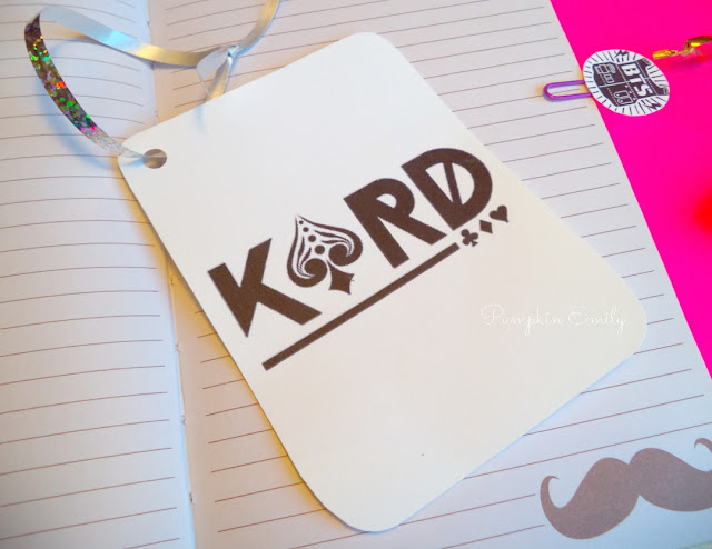 A Card Shaped Bookmark with K.A.R.D's Logo