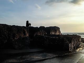 Calm The Mind On Sea Rocks In The Sunset Light At Batu Bolong Beach, Canggu Village, Badung, Bali, Indonesia