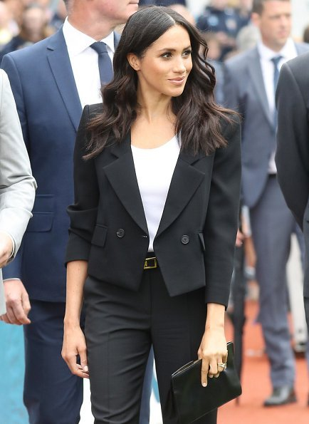 Meghan Markle wore Givenchy black cropped double-breasted blazer and trousers, Sarah Flint Pumps, she carried Givenchy GV3 frame clutch bag