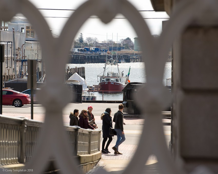 Portland, Maine USA April 2018 photo by Corey Templeton. A view through the Custom House fence towards Commercial Street