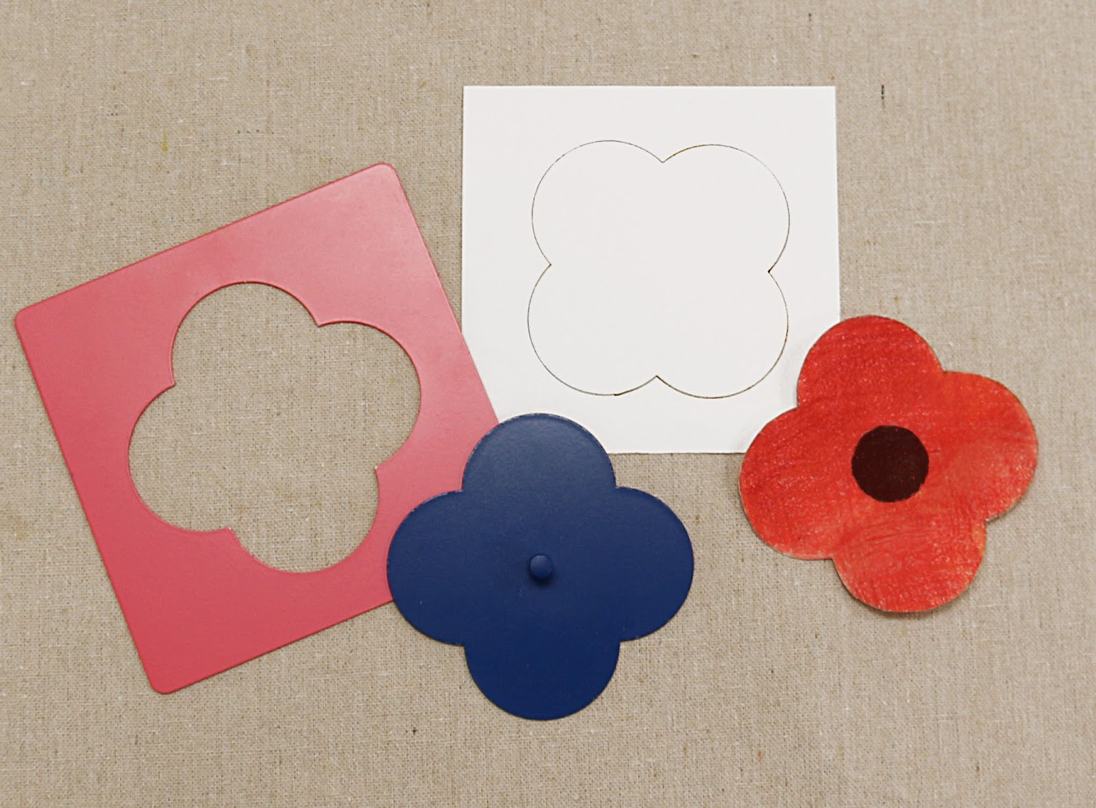 NAMC Montessor Rememberance Veterans Day Activities. Metal Inset quatrefoil poppy