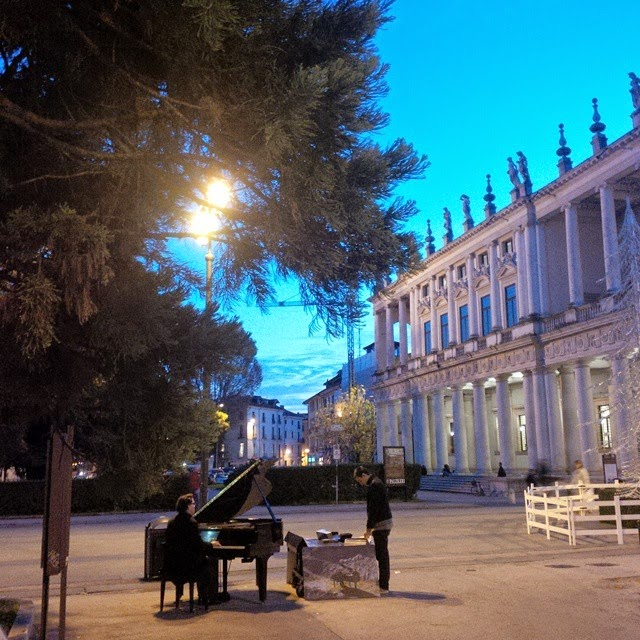 The pianist playing his music opposite Palazzo Chiericati in Vicenza