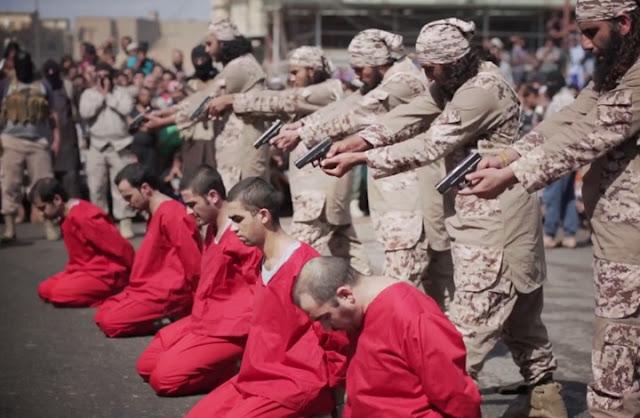 """تنظيم الدولة يعدم عراقيين رسموا حرف """"م"""" على الجدران (صور)"""