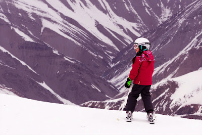 A young girl skiing on the heights of Shemshak Ski resort in Iran.