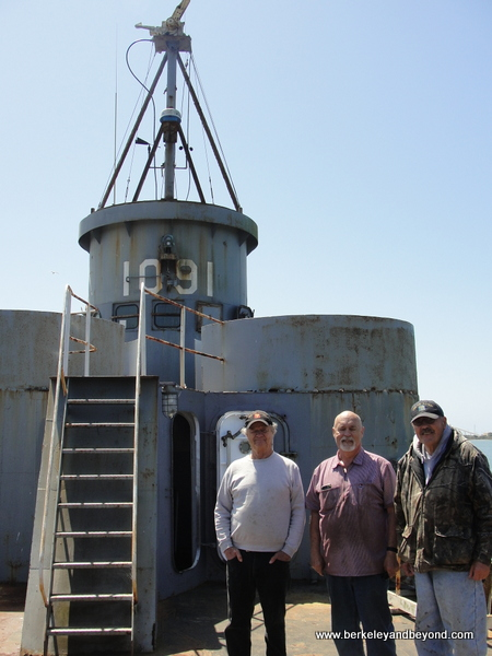 volunteers in front of gun tower on WWII Landing Craft at Humboldt Bay Naval Sea/Air Museum in Eureka, California