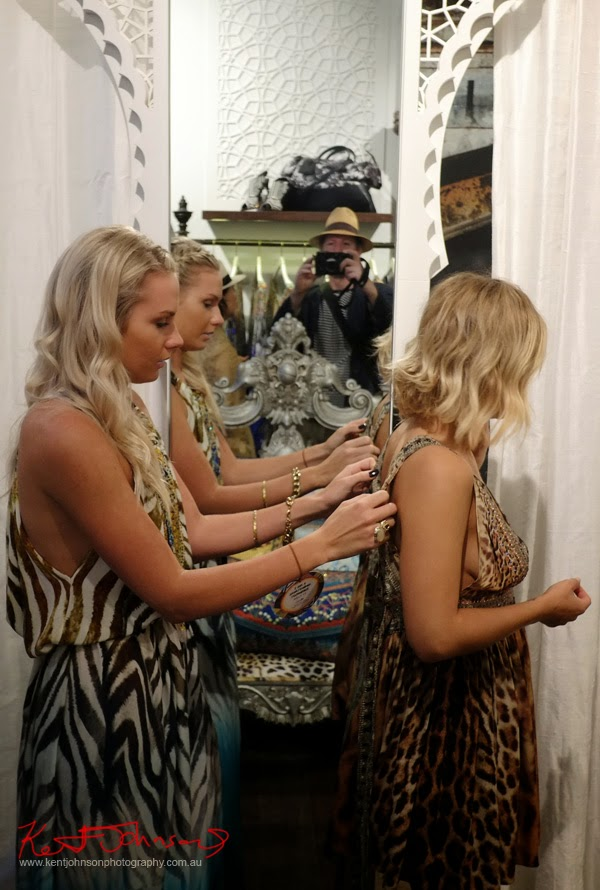 Trying on a kaftan; Camilla Ringleader - Style guide and store launch Paddington Sydney - Photographed by Kent Johnson.