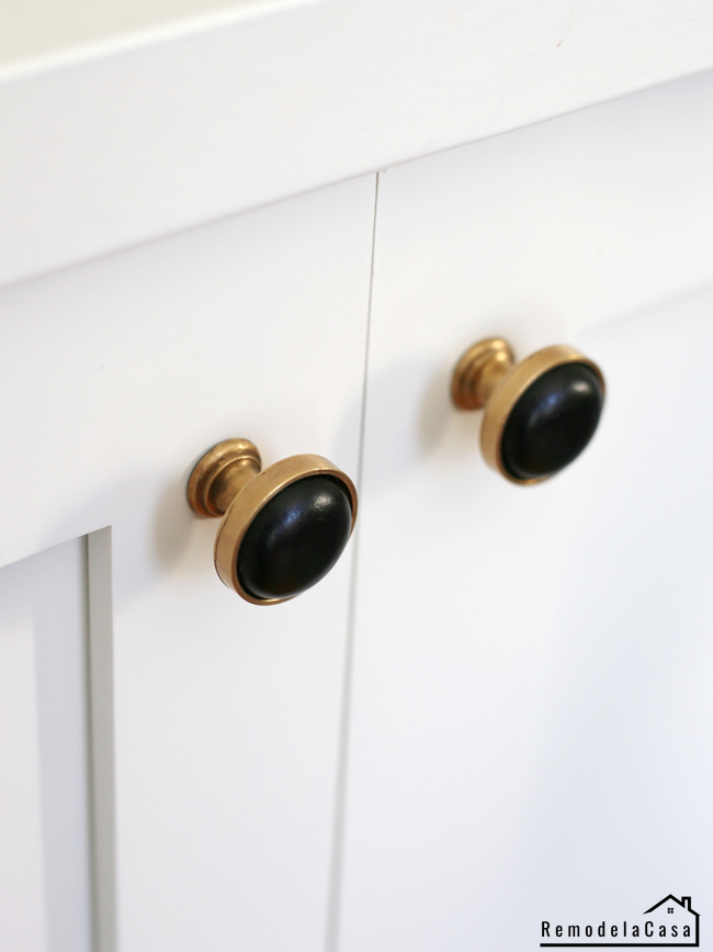Gold and black cabinet door knobs