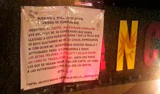 CJNG deja dos maletas con restos humanos y narco-manta en Cancún