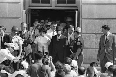 1963: Vivian Malone and James A. Hood stand outside the doorway at the University of Alabama. Governor Wallace was unsuccessful to block these students from attending the University of Alabama.