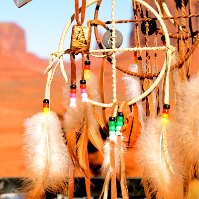 Image of a dream catcher hanging in a desert landscape