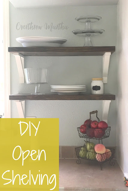 DIY open shelving with wood shelves and white brackets