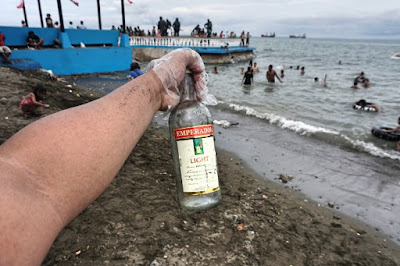 Drinking Emperador at Larawan Beach and leaving trash