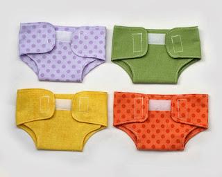 http://littleabbeepatterns.blogspot.com/2014/03/tutorial-doll-diaper-plus-pattern.html
