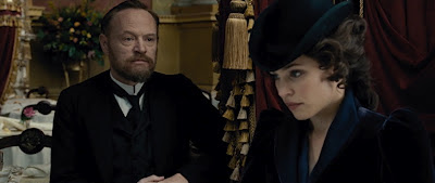 Jared Harris and Rachel McAdams as Prof Moriarty and Irene Adler