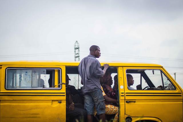 Danfo bus conductor in Lagos