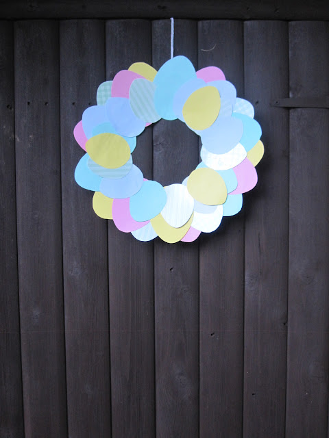 Completed Easter wreath hanging on a wooden door
