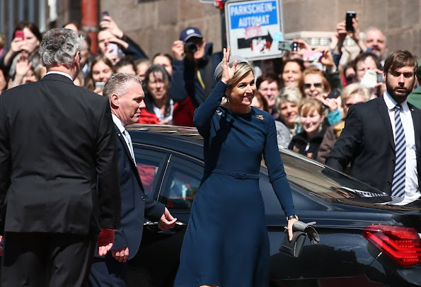 King Willem-Alexander and Queen Maxima of the Netherlands cross the Townhall square