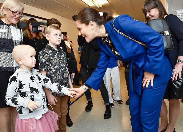 Crown Princess Victoria's Children and Youth Hospital. Erdem x H&M floral blouse Af Klingberg boots, Valentino shoulder bag