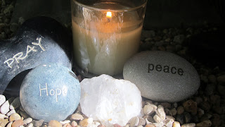 photo of rocks with words and a candle