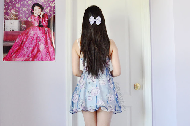A feminine, elegant spring/summer outfit featuring the Dreamin' of Sunshine organza overlay pastel skater bustier dress from Tobi, worn with white spiked Jeffrey Campbell Lita dupe platform booties, a floral hair bow from Oh My Bows, and a tassel-trim white kimono.