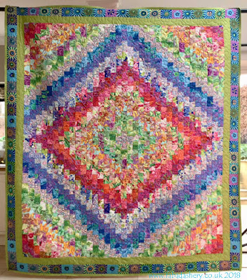 'Trip Around the World' quilt made by Margie,  quilted by Fabadashery Long Arm Quilting