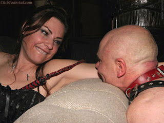 smiling mistress and her slave