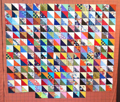 Scrappy half square triangle quilt