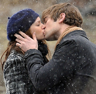 cute-young-lovers-passionate-kissing-in-snow-fall-image.jpg