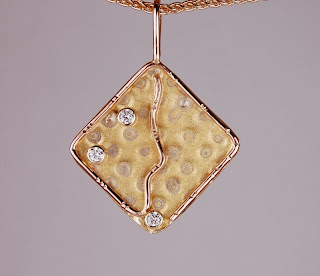 diamond shaped pendant in different colors of gold with diamonds