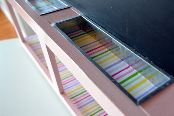 We added some cute and colorful striped wrapping paper to the chalk trays to add even more color.