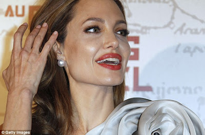In Full Bloom Angelina Jolie Steals The Show In A Flower