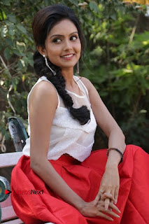 Actress Mahima Nambiar Latest Stills in White Top and Red Skirt at Kuttram 23 Movie Press Meet  0027.jpg