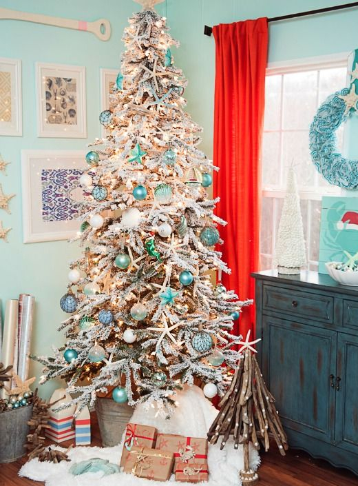 White Flocked Coastal Christmas Tree with Blue Ornaments